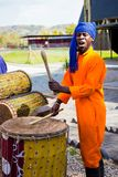 African Men playing traditional drums for Soweto township tourists stock image