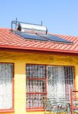 Solar Water Heating Tubes on a roof stock photos