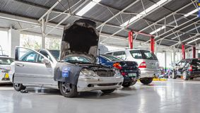 Garage repair shop with cars ready to be fixed. stock photo