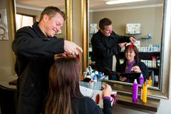 Male Hairdresser with female customer royalty free stock photos