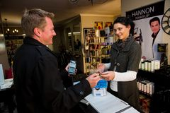 Male Retail Shopper paying with a credit card stock photo