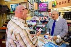Pharmacist assisting a customer in retail pharmacy store royalty free stock image
