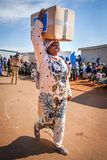African women carrying box on her head. stock photos