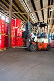 Fork lift truck in a warehouse royalty free stock image