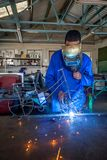 Students welding in a workshop. Johannesburg, South Africa, March 7 - 2018: Students welding in a workshop. Boy welding a bike out of metal wire Royalty Free Stock Photography