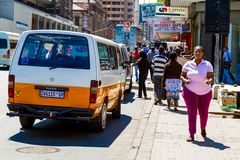 Mini bus taxi on Streets of Johannesburg royalty free stock photo