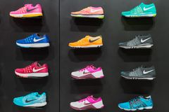 Johannesburg, South Africa - September 12, 2016: Colorful Nike footwears exhibition on black shelf in store of Johannesburg, South. Africa. Nike Inc. is an Royalty Free Stock Images