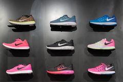Johannesburg, South Africa - September 12, 2016: Colorful Nike footwears exhibition on black shelf in store of Johannesburg, South. Africa. Nike Inc. is an Stock Image