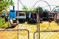 Scrapped Mini Bus Taxi in garden of Soweto Home royalty free stock image