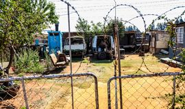 Scrapped Mini Bus Taxi in garden of Soweto Home stock image