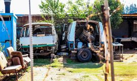 Scrapped Mini Bus Taxi in garden of Soweto Home stock photography