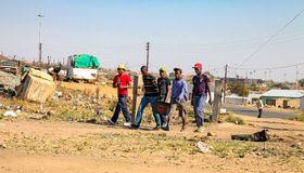 Young African Men walking in urban Soweto South Africa. Johannesburg, South Africa, September 11, 2011, Young African Men walking in urban Soweto South Africa royalty free stock photos