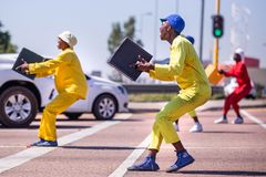 Pantsula dancers at traffic intersection. Johannesburg, South Africa, 29th March - 2019: Street dancers performing at traffic intersection with beer crates stock image