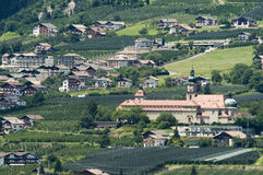 Johanneum in tirol village. Panoramic view of Sankt Georgen on the southern slope of the Merano Valley to the village of Tyrol with its Johanneum in telephoto royalty free stock photography