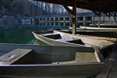 John boats docked during winter royalty free stock image