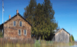 John Brown's Farmhouse Distortion. Farmhouse and barn reflected in a pond for distortion Royalty Free Stock Photo