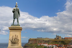 John Cook Memorial. In Whitby, England, overlooking cliffs with Whtiby Abby Royalty Free Stock Image