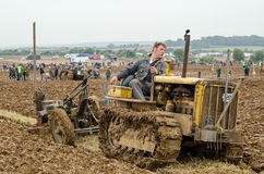 John Crowder, Ploughman. BASINGSTOKE, UK - OCTOBER 12, 2014: John Crowder competing in the second day of the British National Ploughing Championships organised Stock Images