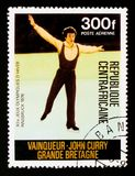 John Curry - Great Britain, Olympic Games in Innsbruck serie, circa 1976. MOSCOW, RUSSIA - AUGUST 29, 2017: A stamp printed in Central African republic shows Royalty Free Stock Images