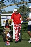 John Daly Golfer 2011 Farmers Insurance Open. John Daly standing by golf bag with clubs, he is wearing his signature wild pants, talking to his caddy. He is at Royalty Free Stock Photos