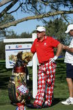 John Daly Golfer 2011 Farmers Insurance Open. John Daly standing by golf bag with clubs, he is wearing his signature wild pants, He is at Torrey Pines Golf Stock Photo