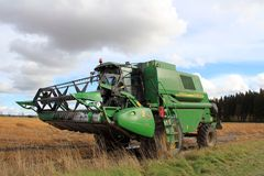 John Deere 1450 CWS Harvester by wet field Stock Photography