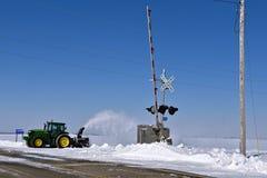 John Deere 6145 ciągnika podmuchowy śnieg obraz royalty free