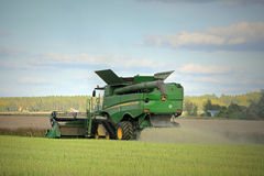John Deere Combine S670i on Rapeseed Field Stock Photos