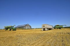 JOHN DEERE COMBINES IN HARVEST FIELD. MAYVILLE, NORTH DAKOTA, Oct 6, 2015: John Deere combines are a product of John Deere Co, an American corporation that Stock Photography