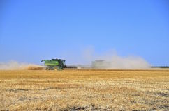 John Deere combines in harvest mode. FARGO, NORTH DAKOTA, August 19, 2015:The John Deere combines harvesting wheat are manufactured by John Deere Company, an Stock Photo
