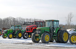 John Deere and Ford Farm equipment. Image of John Deere and ford farm equipment in winter Royalty Free Stock Images