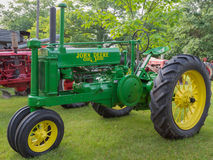 John Deere General Purpose Tractor. A view of a vintage John Deere General Purpose farm tractor stock photos