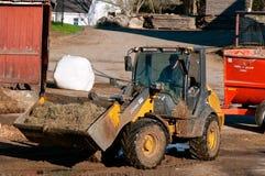 John Deere 205k początkowy ładowacza poruszająca kiszonka fotografia royalty free