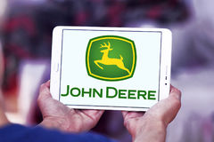John deere logo. Logo of john deere brand on samsung tablet. john deere is an American corporation that manufactures agricultural, construction, and forestry Royalty Free Stock Photo