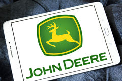 John deere logo. Logo of john deere brand on samsung tablet. john deere is an American corporation that manufactures agricultural, construction, and forestry Royalty Free Stock Image