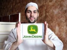 John deere logo. Logo of john deere brand on samsung tablet holded by arab muslim man. john deere is an American corporation that manufactures agricultural Stock Images