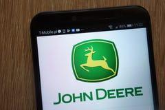 John Deere logo wystawiający na nowożytnym smartphone zdjęcie royalty free