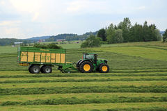 John Deere 6210R Agricultural Tractor and Krone MX 350 GL Forage Stock Images