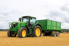 John Deere 6170R Agricultural Tractor and Palmse 1900 Trailer stock photos