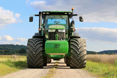 John Deere 7280R Agricultural Tractor on a Rural Road Royalty Free Stock Photo