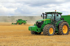 John Deere 7280R Agricultural Tractor and T560 Combine Harvester Stock Image