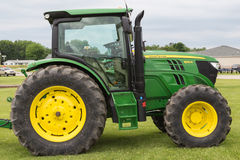 John Deere 6125R Farm Tractor. A John Deere Model 6125 enclosed cab farm tractor Royalty Free Stock Photos