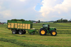 John Deere 6210R Tractor and Full Krone MX 350 GL Forage and Dis Stock Photography