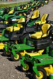 John Deere riding lawn mower tractors. HAWLEY, MINNESOTA, August 22, 2017: A row of green and yellow new riding lawn mower tractors are products of John Deere Co Stock Photos