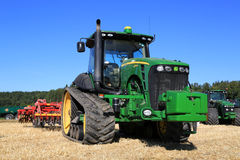 John Deere 8345RT Track Tractor and Vaderstad Cultivator on Fiel Royalty Free Stock Images
