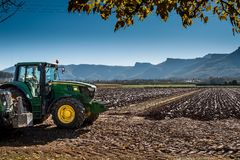 John Deere`s tractor after plowing the field royalty free stock images
