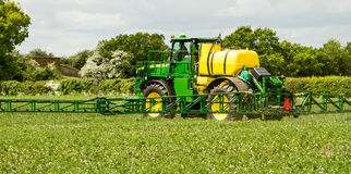 John Deere sprayer spraying in bean field Royalty Free Stock Photos