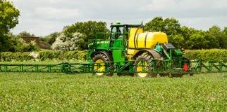 John Deere sprayer spraying in bean field Royalty Free Stock Photos