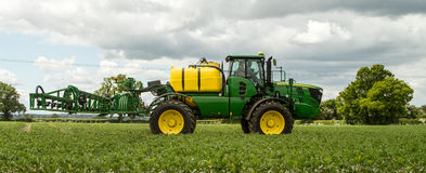 John Deere sprayer spraying in bean field Royalty Free Stock Images