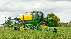John Deere sprayer spraying in bean field Stock Photo